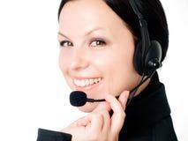 Femme de sourire parlant par l'écouteur Images stock
