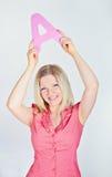 Femme de sourire tenant la lettre A Photographie stock libre de droits