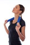 femme de sport avec l'essuie-main sur un blanc Photographie stock