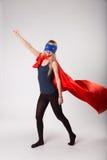 Femme de superhéros dans le costume de superwoman Image stock