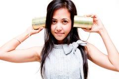 Femme de téléphone de boîte en fer blanc Photographie stock libre de droits