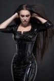 Femme de vamp avec les yeux rouges Photo stock