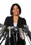 Femme derrière des microphones Photographie stock