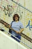 Femme derrière une frontière de sécurité Photo libre de droits