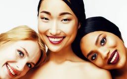 Femme différente de la nation trois : Asiatique, afro-américain, caucasien Images stock