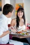 Femme dinant avec l'associé Photographie stock