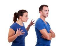 Femme discutant avec un homme Photo libre de droits