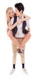 Femme donnant à son associé lesbien un tour de ferroutage Photos libres de droits