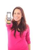 Femme donnant le téléphone portable Photographie stock