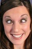 Femme drôle de visage observé par croix Photo stock