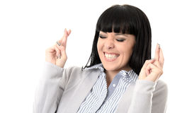 Femme désireuse sûre pleine d'espoir déterminée avec des doigts croisés Photos stock