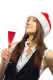 Femme en cocktail potable de chapeau de Noël Image stock