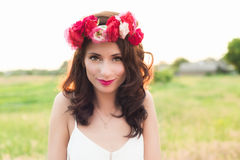 Femme en guirlande Photographie stock