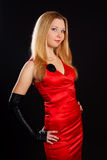 Femme en rouge. Photos stock