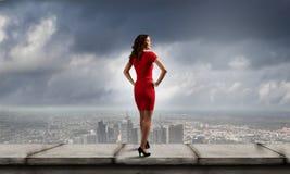 Femme en rouge Images stock