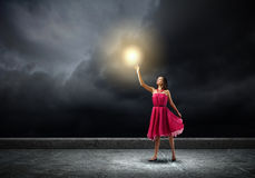 Femme en rouge Photographie stock libre de droits