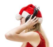 Femme en rouge avec des écouteurs photo libre de droits