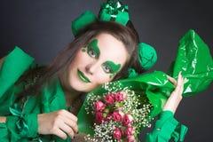 Femme en vert. Photo stock