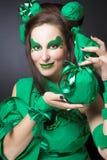 Femme en vert. Image stock