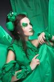Femme en vert. Photographie stock
