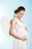 Femme enceinte avec des ailes d'ange Image stock