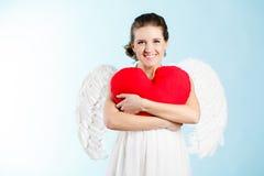 Femme enceinte avec des ailes d'ange Images stock