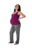 Femme enceinte avec douleur dorsale Photo stock