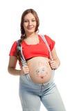 Femme enceinte avec drowing drôle sur le son ventre Image stock