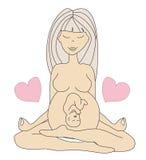 Femme enceinte de yoga en position de lotus Photos stock