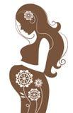 Femme enceinte en fleurs Images stock