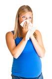 Femme enceinte essuyant le nez Photo stock