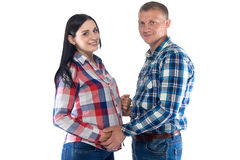 Femme enceinte et son mari regardant l'appareil-photo photos stock