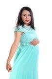 Femme enceinte habillée élégante image libre de droits