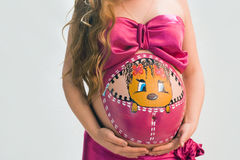 Femme enceinte sur le fond blanc Photos stock