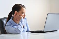 Femme ennuyé au travail Image stock
