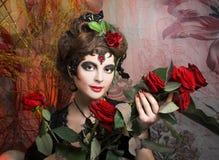 Femme espagnol avec le ventilateur rouge Photographie stock libre de droits