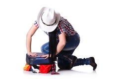 Femme essayant d'emballer trop d'isolement Photographie stock