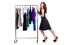 Femme essayant le vêtement neuf Photo stock