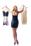 Femme essayant les robes neuves Image stock
