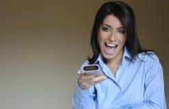Femme et à télécommande heureux Images libres de droits