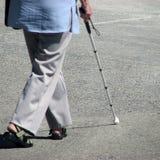 Femme et bâton Photo stock