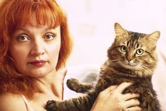 Femme et chat Photographie stock