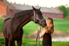 Femme et cheval Images stock