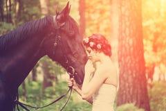 Femme et cheval photos stock