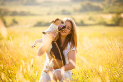 Femme et chien Photographie stock