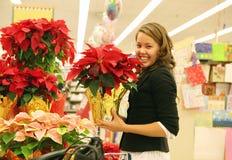 Femme et fleurs Images stock