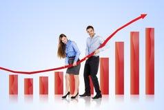 Femme et homme avec la courbe de statistiques image libre de droits
