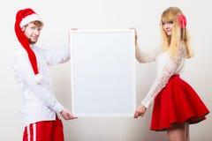Femme et homme de couples avec la bannière vide Copiez l'espace Photographie stock libre de droits