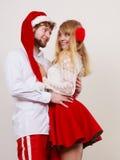 Femme et homme mignons heureux de couples Noël Photographie stock