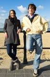 Femme et homme sur la plage Photographie stock